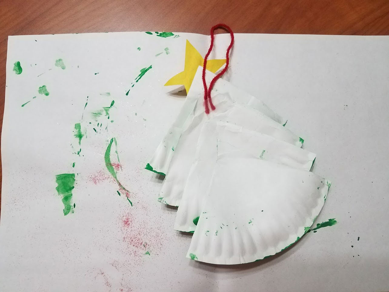 Making the Christmas tree hanger using yarn and tape